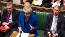 Britain's Prime Minister Theresa May speaks during a debate before a no-confidence vote on Theresa May raised by opposition Labour Party leader Jeremy Corbyn, in the House of Commons, London, Wednesday, Jan. 16, 2019. (Mark Duffy, UK Parliament via AP)