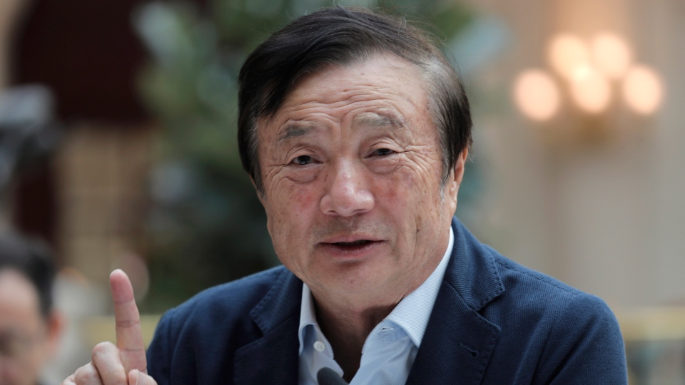 Ren Zhengfei, founder and CEO of Huawei, gestures during a round table meeting with the media in Shenzhen city, south China's Guangdong province, Tuesday, Jan. 15, 2019. (AP Photo/Vincent Yu)