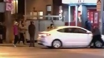 Man clings to car in downtown incident