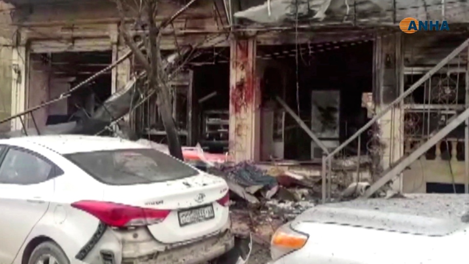 This frame grab from video provided by Hawar News, ANHA, the news agency for the semi-autonomous Kurdish areas in Syria, shows a damaged restaurant where an explosion occurred, in Manbij, Syria, Jan. 16, 2019. (ANHA via AP)