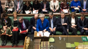 U.K. Prime Minister Theresa May talks during a debate before a no-confidence vote raised by opposition Labour Party leader Jeremy Corbyn, in the House of Commons, London, Wednesday Jan. 16, 2019. Prime Minister May has won a no confidence vote Wednesday. (Mark Duffy, UK Parliament via AP)