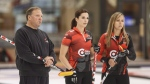 Coach Marcel Rocque, Lisa Weagle and skip Rachel Homan, look over the shot during practice in Leduc, Alta., on September 7, 2018. THE CANADIAN PRESS/Jason Franson