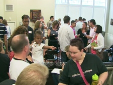 Dozens of families met in Etobicoke on July 19, 2009 to discuss their options after an Ontario adoption agency filed for bankruptcy.