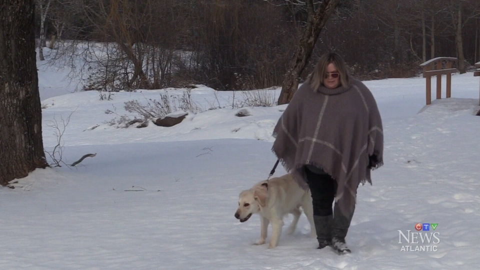 Susan Atkinson and her dog stormy are shown near the river in Oxford, N.S.
