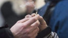 A marijuana joint is shared at Cannabis Culture in Montreal, Friday, December 16, 2016. (THE CANADIAN PRESS/Graham Hughes)