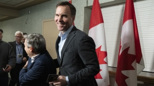 Finance Minister Bill Morneau jokes with Infrastructure and Communities Minister Francois-Philippe Champagne as he arrives for a cabinet meeting in Sherbrooke, Que., Wednesday, Jan. 16, 2019. (THE CANADIAN PRESS/Paul Chiasson)