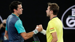 Canada's Milos Raonic, left, is congratulated by Switzerland's Stan Wawrinka after winning their second round match at the Australian Open tennis championships in Melbourne, Australia, Thursday, Jan. 17, 2019. (AP Photo/Aaron Favila)