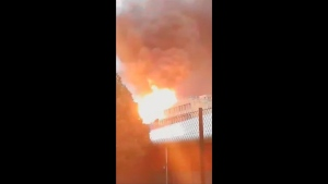 This image taken from video, shows an explosion on the roof of a building at the University of Lyon, France, Thursday Jan. 17, 2019. A strong explosion and fire hit a science building undergoing repairs at the university, injuring three people slightly, French officials said. (Yassmin Officiel via AP)