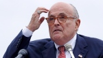 FILE - In this Aug. 1, 2018 file photo, Rudy Giuliani, an attorney for President Donald Trump, addresses a gathering during a campaign event fin Portsmouth, N.H. (AP Photo/Charles Krupa, File )