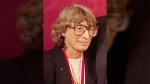 """In this Nov. 18, 1992 file photo, Mary Oliver appears at the National Book Awards in New York where she received the poetry award for her book """"New and Selected Poems."""" (AP Photo/Mark Lennihan)"""