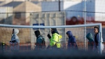 In this Dec. 13, 2018, file photo, teen migrants walk in line inside the Tornillo detention camp in Tornillo, Texas. Government investigators say many more migrant children may have been separated from their parents than the Trump administration has acknowledged. (AP Photo/Andres Leighton, File)