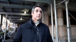 In this Dec. 7, 2018 file photo, Michael Cohen, former lawyer to President Donald Trump, leaves his apartment building in New York. (AP Photo/Richard Drew, File)