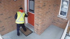 Canada Post worker leaves slip before delivery