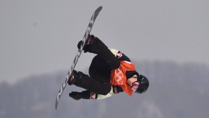 Canada's Max Parrot of Bromont, Que. flies through the air during his second run in the men's snowboard slopestyle qualification at the Phoenix Snow Park at the 2018 Winter Olympic Games in Pyeongchang, South Korea on February 10, 2018. THE CANADIAN PRESS/Jonathan Hayward