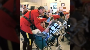 RCMP officer dances with woman on her 100th birthd
