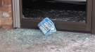 Smashed glass lays at the foot of a shop's front door after a break-in in Collingwood, Ont. on Thursday, Jan. 17, 2019 (CTV News/Roger Klein)