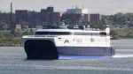 The CAT, a high-speed passenger ferry, departs Yarmouth, N.S. heading to Portland, Maine on its first scheduled trip on Wednesday, June 15, 2016. (THE CANADIAN PRESS/Andrew Vaughan)