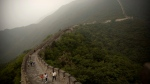 Chinese tourists walk along the Mutianyu section of the Great Wall of China on a foggy day on the outskirts of Beijing, Monday, Sept. 25, 2017. THE CANADIAN PRESS/AP, Mark Schiefelbein