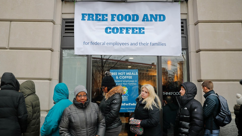 People wait in line at Chef Jose Andres' World Central Kitchen for free meals to workers effected by the government shutdown, Wednesday, Jan. 16, 2019 in Washington. (AP Photo/Pablo Martinez Monsivais)