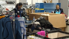 Staff sort through donations at Goodwill in Edmonton.