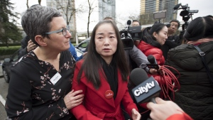 Former Burnaby South candidate Karen Wang is asked to leave the site where she had called a news conference for by Burnaby Public Library Chief Librarian Beth Davies in Burnaby, B.C. Thursday, Jan. 17, 2019. THE CANADIAN PRESS/Jonathan Hayward