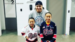 Anthem singers perform in Cree