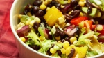 This January 2018 photo shows southwestern black bean and corn salad in New York. This dish is from a recipe by Katie Workman. (Mia via AP)