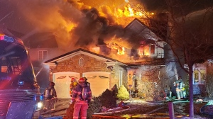 Firefighters work to put out flames at a home on Livingstone Crescent on January 17th, 2019 (@WRPSToday)