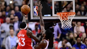 Toronto Raptors forward Pascal Siakam (43) scores the game winning basket over Phoenix Suns center Deandre Ayton (22) during half NBA basketball action in Toronto on Thursday Jan. 17, 2019. THE CANADIAN PRESS/Frank Gunn
