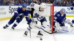 Toronto Maple Leafs left wing Andreas Johnsson (18) controls the puck in front of Tampa Bay Lightning defenseman Dan Girardi (5) and goaltender Andrei Vasilevskiy (88) during the third period of an NHL hockey game, Thursday, Jan. 17, 2019, in Tampa, Fla. (AP Photo/Chris O'Meara)