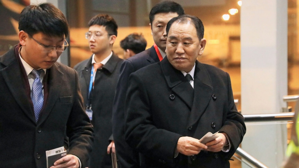 North Korean official Kim Yong Chol, right, prepares to leave the Beijing International Airport in Beijing Thursday, Jan. 17, 2019. Kim arrived in Beijing on Thursday, reportedly en route to the United States for talks ahead of a possible second summit between President Donald Trump and North Korean leader Kim Jong Un. (Kyodo News via AP)