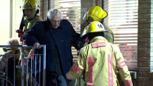 Firefighters help a resident out of building and into emergency shelter on Thursday Jan. 17, 2018 (CTV Montreal/Cosmo Santamaria)