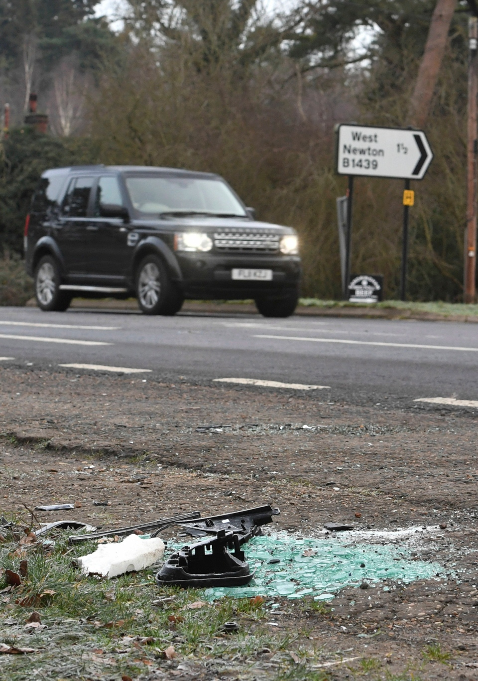 Broken glass and car parts on the road side near to the Sandringham Estate, England, where Prince Philip was involved in a road accident Thursday while he was driving, Friday Jan. 18, 2019. (John Stillwell/PA via AP)