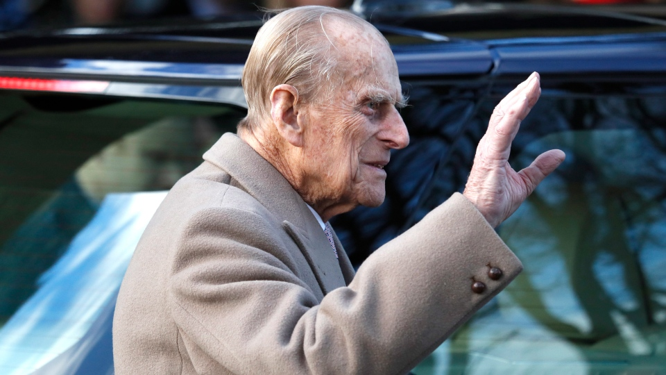 In this Sunday, Dec. 25, 2016 file photo, Britain's Prince Philip waves to the public as he leaves after attending a Christmas day church service in Sandringham, England.  (AP Photo/Kirsty Wigglesworth, file)