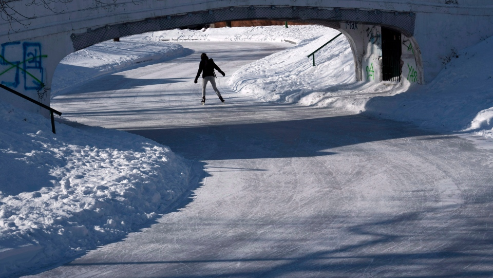 A lone skater braves the cold weather to skate in a Montreal park on Monday, January 14, 2019. THE CANADIAN PRESS/Paul Chiasson