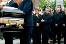 Ida Gatti, mother of former world champion boxer Arturo Gatti, and his step-father, Geraldo Di Francesco, watch his coffin arrive for a funeral service in Montreal, on July 20, 2009. (Graham Hughes / THE CANADIAN PRESS)