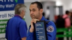 A Transportation Security Administration (TSA) employee works at a security checkpoint at Miami International Airport, Friday, Jan. 18, 2019, in Miami. The three-day holiday weekend is likely to bring bigger airport crowds. (AP Photo/Lynne Sladky)