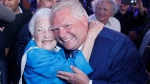 Ontario PC leader Doug Ford is congratulated by former Mississauga mayor Hazel McCallion after winning a majority government in the Ontario Provincial election in Toronto, on Thursday, June 7, 2018. (THE CANADIAN PRESS/Mark Blinch)