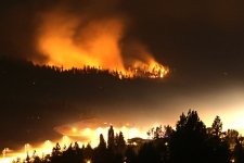 A wildfire burns out of control as smoke hangs above Kelowna, B.C., in the early morning hours of Monday July 20, 2009. (Darryl Dyck / THE CANADIAN PRESS)