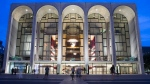 In this Aug. 1, 2014, file photo, pedestrians make their way in front of the Metropolitan Opera house at New York's Lincoln Center. (AP Poto/John Minchillo, File)