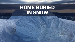 Helicopter footage shows home covered in snow
