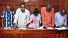 From left to right, suspects Osman Ibrahim, Canadian Guleid Abdihakim, Gladys Kaari Justus, Oliver Kanyango Muthee and Joel Nganga Wainaina appear at a hearing at Milimani law courts in Nairobi, Kenya Friday, Jan. 18, 2019. Police who are investigating this week's extremist attack on a Nairobi hotel complex asked the court that the suspects who are accused of involvement in the attack be held for 30 days in order for the police to complete their investigations, which the court granted. (AP Photo)