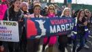 In this Jan. 20, 2018 file photo, House Minority Leader Nancy Pelosi of Calif, center, marches in the Women's March as they walk to the White House from the Lincoln Memorial in Washington. (AP Photo/Cliff Owen)