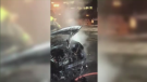 By the time firefighters arrived at the scene, black smoke was billowing from the parked vehicle - an electric TEO taxi - on McGill Avenue in downtown Montreal. (CTV Montreal)