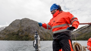 Marine biologist Marco Pinto holds a conductivity, temperature, and depth measurement instrument (CTD), during research in Seno Ballena fjord at Santa Ines island in Punta Arenas. (Martin BERNETTI / AFP)