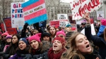 Participants at the Women's March NYC, a rally at Foley Square in Lower Manhattan react as loud music is played between speakers, Saturday, Jan. 19, 2019, in New York. (AP Photo/Kathy Willens)