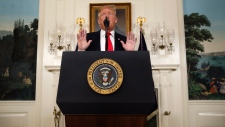 U.S. President Donald Trump speaks about the partial government shutdown, immigration and border security in the Diplomatic Reception Room of the White House, in Washington, Saturday, Jan. 19, 2019. (AP Photo/Alex Brandon)