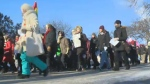 Around 100 people took part in the march on the grounds of the Manitoba legislature. (File image.)