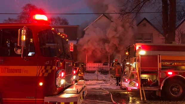 Firefighters surround a burning home on Lambton Avenue on Jan. 19, 2019. (Peter Muscat)