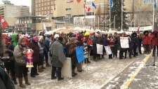 Dozens of Edmontonians turned out to Winston Churchill Square Saturday to march in solidarity with other women's marches being held across Canada and the U.S.